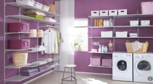 purple-paint-in-wall-of-laundry-room-with-white-washer-dryer