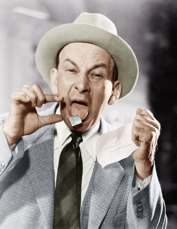 Man with a postage stamp stuck on his tongue